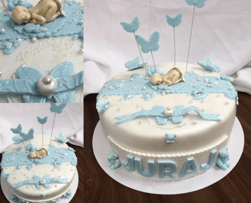 Detská torta s chlapcom na krst s mašličkami a perličkami