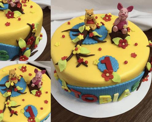 Detská torta s mackom Pú a prasiatkom, kvetinkami a konárikmi