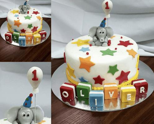 Detská biela torta so sloníkom a farebnými kockami