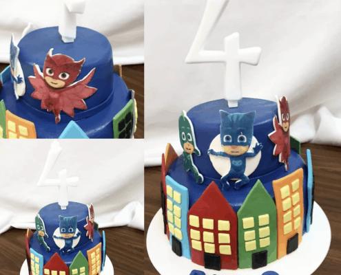 Detská torta mesto s panelákmi a superhrdinami