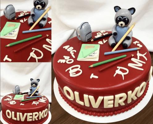 Detská torta s pastelkami, mývalom a školským zošitom