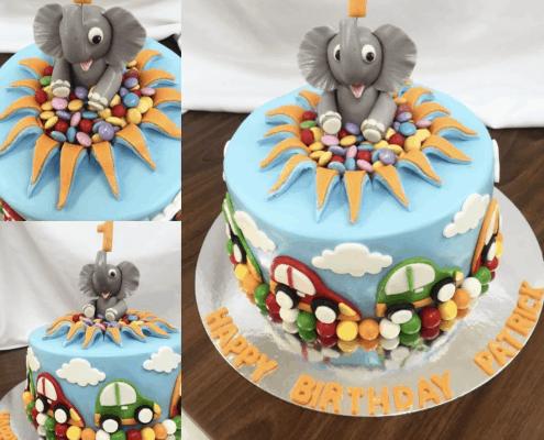 Modro oranžová torta s autíčkami a vyskakovacím sloníkom