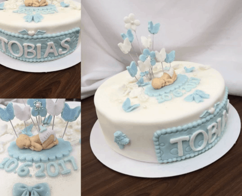 Torta na krst s bábätkoma modro bielymi dekoráciami