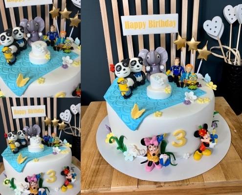 Biela torta s postavičkami Walt disney na party